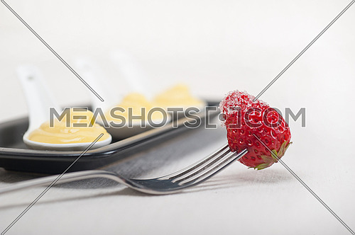 custard pastry cream and strawberry on a fork