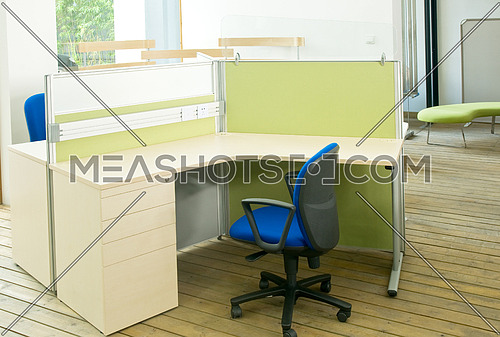 office desks and blue chairs cubicle set view from top over wood flooring