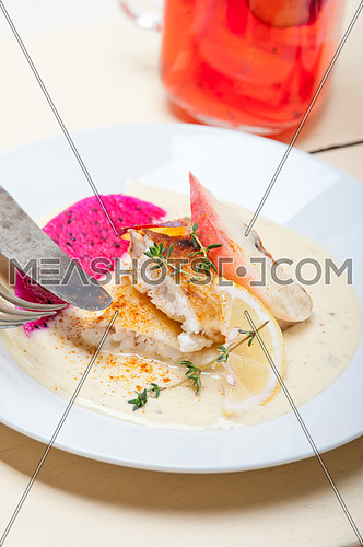 sea bream orata  fillet butter pan fried with fresh peach prune and dragonfruit slices thyme on top