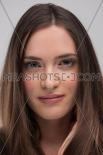 beautiful young brunette woman in a gray dress posing and expresses different emotions. close-up portret