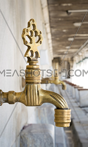 Turkish Ottoman style antique ablution tap at the ablution fountain in front of Sultan Ahmed Mosque (Sultan Ahmet, Blue Mosque), Istanbul, Turkey