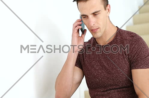 Man using cell phone in luxuary villa