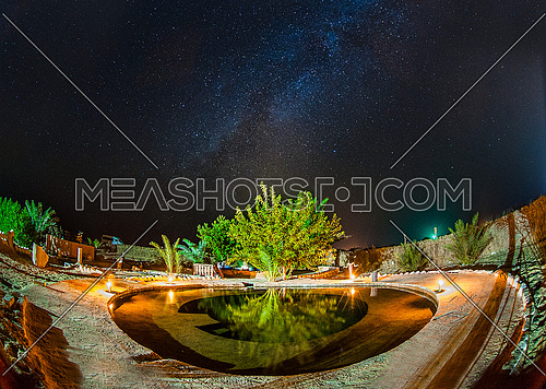 A beautiful view of the Siwa Oasis in Egypt for the eye of groundwater in the middle of Western Sahara also shows the Milky Way galaxy