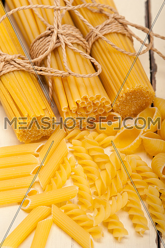 bunch of Italian pasta type on a white rustic table