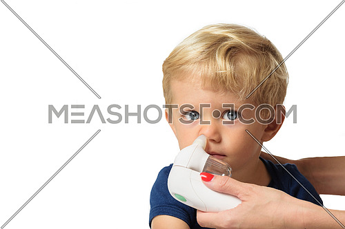 Mother using baby electric nasal aspirator. She is doing a mucus suction to twenty months baby boy,white backgrounds.