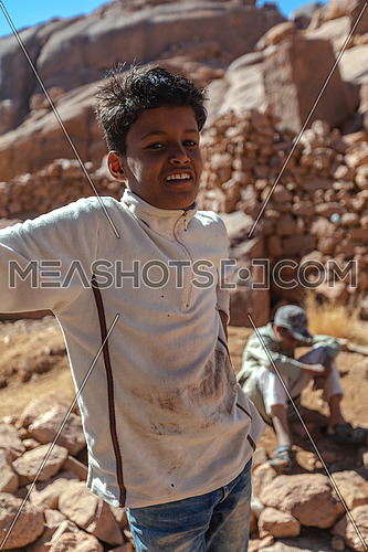 Portrait for a bedouin child at ain hadra in Sinai Mountain by day