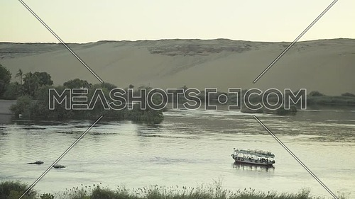 Aerial Shot for the River Nile showing motorboats in Aswan at Day