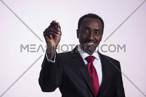 african business man draw with marker on virtual screen