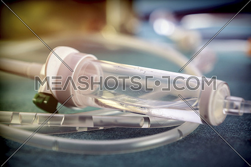 Detail of rubbers of a drip irrigation equipment in hospital operations table, conceptual image