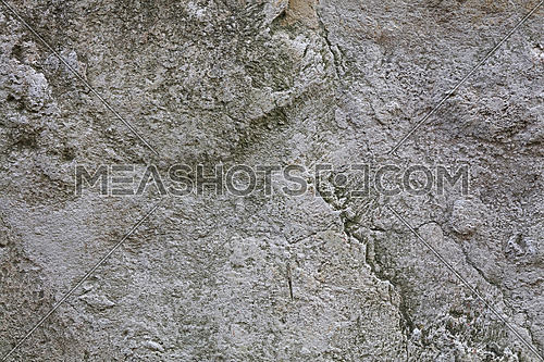 Gray and white rough natural stone surface grunge background texture close up