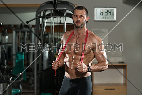 Handsome Muscular Man With Jumping Rope