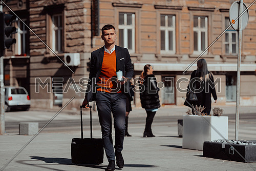 a businessman with a coffee in his hand and a suitcase while walking around the city