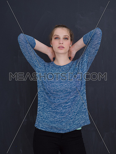 portrait of Beautiful young woman isolated on grey background