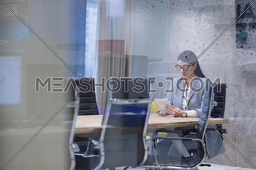 Businesswoman using tablet at the work in office