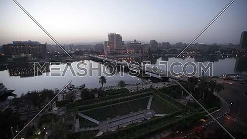 Ariel shot for DownTown showing Qasr Al Nile Bridge and Nile Ritz Carlton Hotel at dusk.