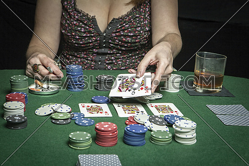 Attractive woman playing a game of poker
