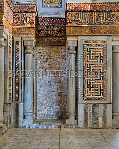 Interior view of decorated marble walls surrounding the cenotaph in the mausoleum of Sultan Qalawun, part of Sultan Qalawun Complex built in 1285 AD, located in Al Moez Street, Old Cairo, Egypt