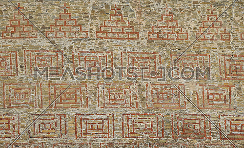 Antique stone wall texture with red bricks hacking ornament pattern
