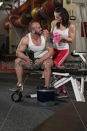 Young Couple Bodybuilder With Shaker Pills And Dope For Copy Space