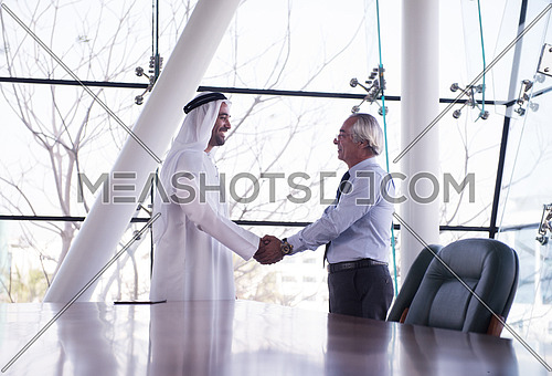 arabian businessman make deal and handshake with company director at modern meeting room