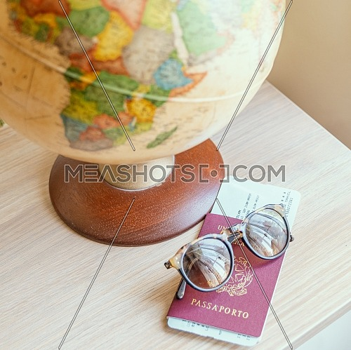 globe,sun glasses,ticket airplane and passport on a wooden table. Idea, photo tourism, adventure, travel around the world