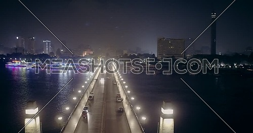 Aerial shot from drone fly around Kasr Al Nile Bridge in Cairo at night
