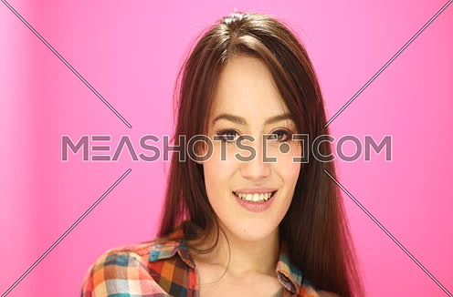 Portrait Of An Attractive Young woman dancing and doing crazy things in front of camera