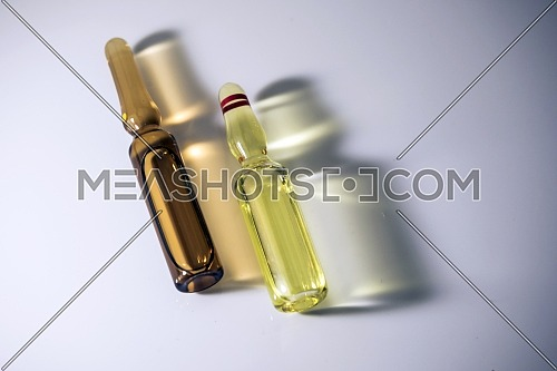 Two vials illuminated laterally, conceptual image