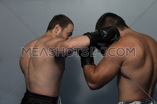 Strong Boxer And His Opponent During A Box Fight In A Ring