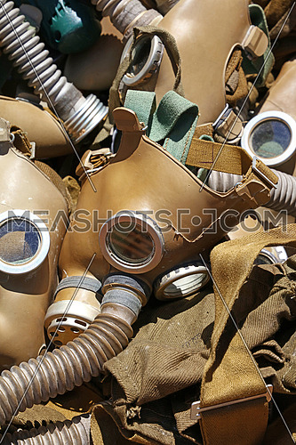Close up selection of old vintage worn respirator gas masks at retail market stall display