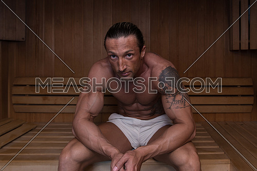 Good Looking And Attractive Mature Man With Muscular Body Relaxing In Sauna Hot