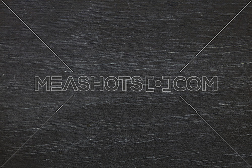 Old aged black painted chalkboard blackboard background texture with splits and cracks, close up