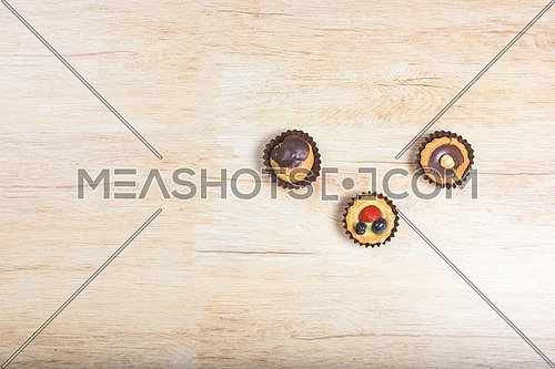 three Italian pastry above and wood background
