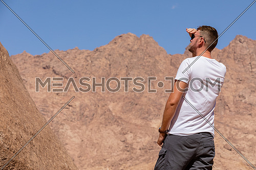 A shot for a male tourist exploring Sinai Mountain in wadi Freij by day.