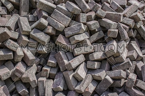 Heap of cobblestones background, paving stone building material at construction site