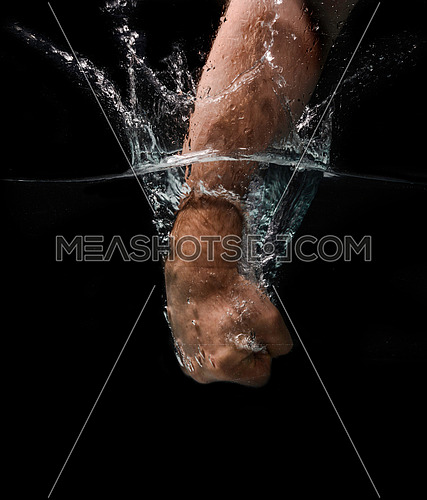Fist Punch in the water at high speed isolated on black