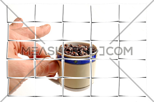 cup of coffee beans on white background