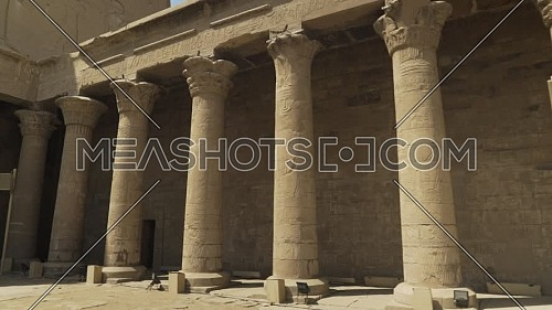 Follow shot for columns inside the Temple of Edfu Egypt by day