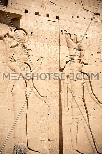 Queen Isis supporting her Son Horus on the walls of Isis Temple in Island of Philae In Aswan