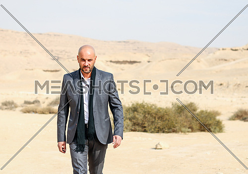 a business man Walking in desert