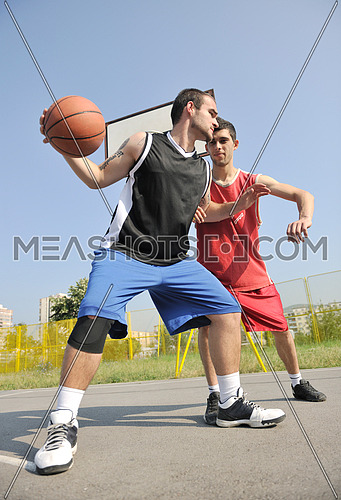 streetball basketball game with two young player at early morning on city court