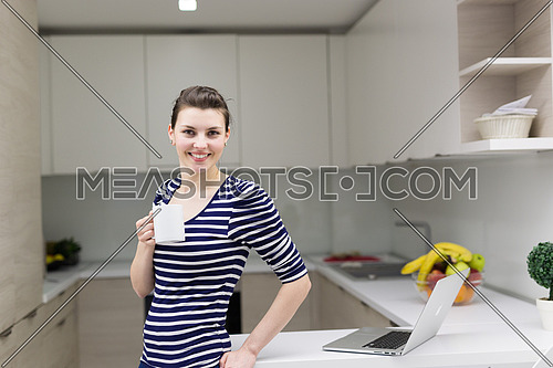 Real Woman Using laptop At Home Drinking Coffee Enjoying Relaxing