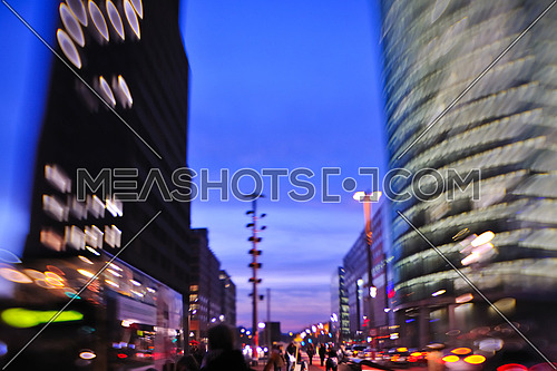 busy traffic scene of street in night  with car traffic and vivid colored city scene