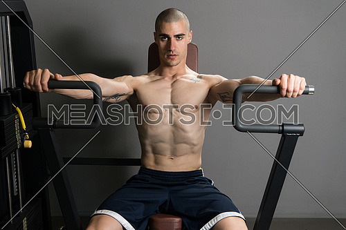 Young Bodybuilder Doing Heavy Weight Exercise For Chest