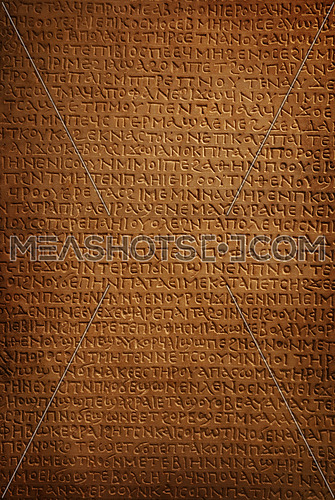 Close up background of ancient Coptic Egyptian stone carved petroglyph hieroglyphs