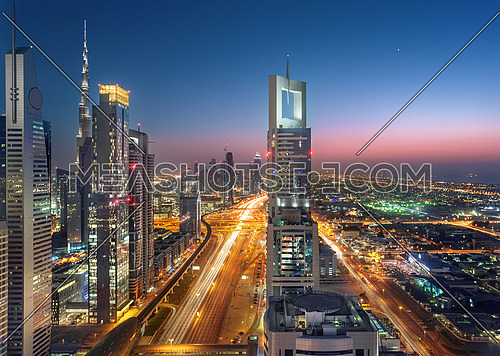 Dubai Sheikh Zayed Road by sunset with heavy traffic streets