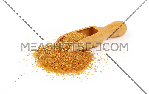 Close up one wooden scoop spoon full of raw brown cane sugar with pinch spilled and spread around, isolated on white background, low angle view