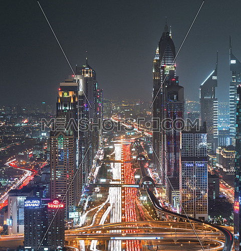 sheikh zayed road towers at night showing interchange