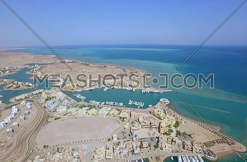 Zoom Out using Drone shot flying above Al Gouna at Day