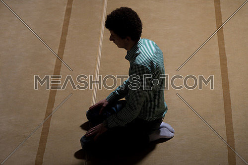 White Muslim Man Is Praying In The Mosque - Afro Lock Hair Curly